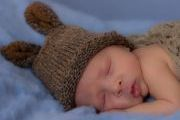 maternity and newborn photography - newborn baby boy with bunny ears hat