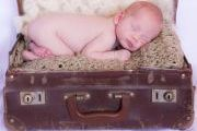 maternity and newborn photography - newborn baby in antique suitcase